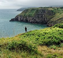 A man looking at the sea at Bery Head, Devon by atomov