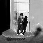 B&W0001. Little boy on street corner. www.tgsdarkroom.com by tgsdarkroom
