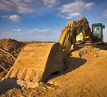 Large yellow excavator by Mikhail Lavrenov