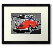 Orange Volkswagen Kombi with surfboard. Framed Print