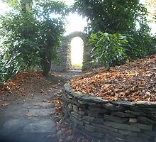 Arched gateway in the garden of Joanne Harris by RichardArtist
