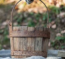 old wooden bucket at the well by spetenfia