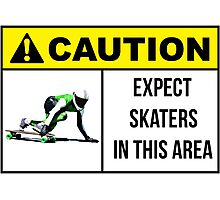 Caution sign. Expect skaters in this area. Photographic Print