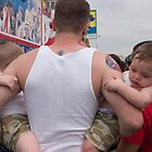 Father and Twins Watching Nathan's Hotdog Eating Contest by jhorn1