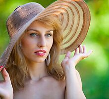 Beautiful blonde with hat outdoors by naturalis