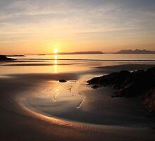 Sunset over Eigg. by John Cameron