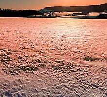 Snow, fields and a winter sunset | landscape photography by Patrick Jobst