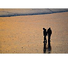Couple on beach at sunset Photographic Print