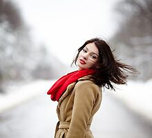 Beautiful brunette with hair blown by wind in the winter by naturalis