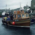 Boat setting out for Farne from Sea Houses Bamburgh Northumberland England 198405280002m  by Fred Mitchell