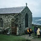 People outside 1370 church in memory of St Cuthbert who died here 687 on Farne island off Sea Houses Bamburgh Northumberland England 198405280019m by Fred Mitchell