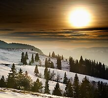 Sunset on snowy mountains by naturalis