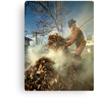 Old farmer burning dead leaves Canvas Print
