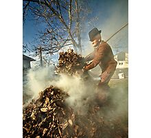 Old farmer burning dead leaves Photographic Print