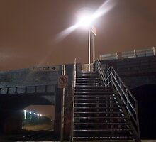 Steel Steps on Train Platform at Night by Rob Davies
