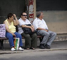 Three strangers on one bench by Moshe Cohen