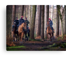 Horse riders in forest Canvas Print