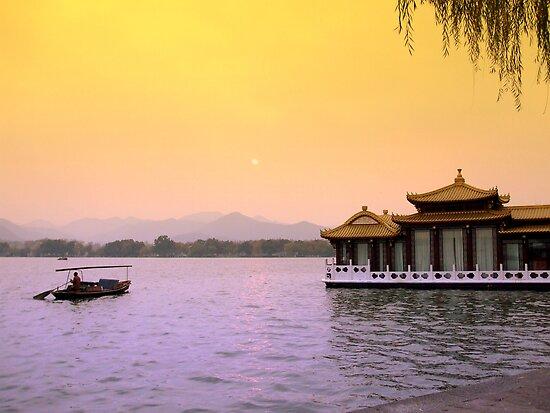 Chinese boat on West Lake, in Hangzhou China by Patrick Czaplewski