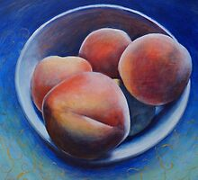 Ripe, fuzzy peaches on a blue background by soniamattson