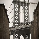 Empire State Building through arch of Manhattan Bridge by Alan Copson