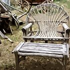Stylized antique lawn chair and table photo. by NaturaLight