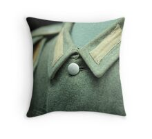 button on a soldier's uniform Throw Pillow