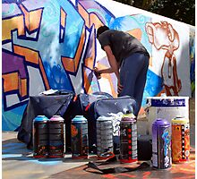 Graffiti Artist at Work with Tools Photographic Print