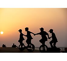 Children on one wheel bicycle Photographic Print