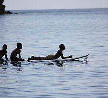 boys on a surfboard by james veira