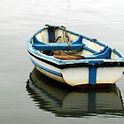 boat on the water, reflection by Stan Daniels