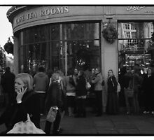 "Queuing for Tea at ""Bettys"" by John Tuffen"