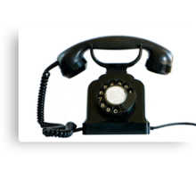 Old black phone isolated on white.   Canvas Print