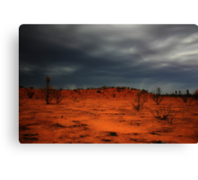 Red dirt.  Black Clouds. Canvas Print
