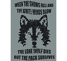 When the snows fall and the white winds blow, the lone wolf dies but the pack survives. Photographic Print