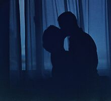 Blue silhouette couple kissing analogue film photograph by edwardolive