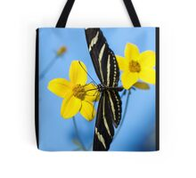 A zebra longwing butterfly, Heliconius charitonius, is sipping nectar from a flower Tote Bag