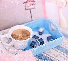 Cup of coffee on blue wooden tray with chocolate by Oksana Ariskina