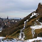 Salisbury Crags and Edinburgh Castle in winter by ljm000