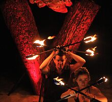 Fire twirlers by Robyn Lakeman