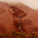 uluru in thunder storm by mickeyb