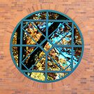 cropped reflection on round window by Hannah Grubb