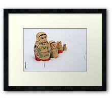 Russian dolls in snow Framed Print