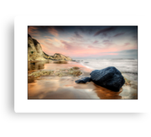 Black rock on White rocks Beach Canvas Print