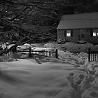 Snow Covered House at Night by Jonathan Eggers