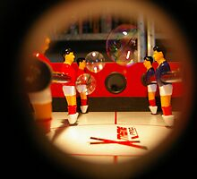 Playing with Bubbles - Tabletop soccer porthole photograph by CDCcreative