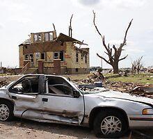 Tornado damaged car and house in Greensburg  by jdeguara
