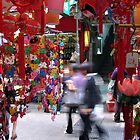 Busy Street in Hong Kong by Kos Cos
