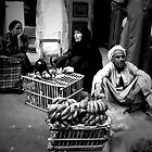 People in Luxor Market, Egypt by Monica Di Carlo