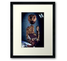 M Blackwell - The Creator Consults His Manual... Framed Print
