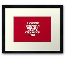 A cheese sandwich doesn't make a very good hat Framed Print